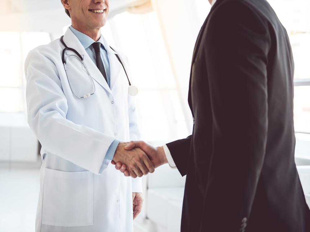 Doctor Shaking Mans Hand